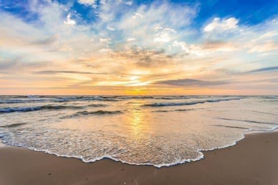 Foto op Tuindoek, Zonsondergang op het Hollandse strand